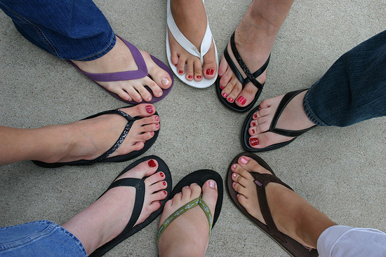 different painted toes pointing towards each other in a circle