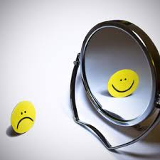 Mirror reflection of smiling faces