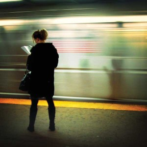 Lady on train station platform